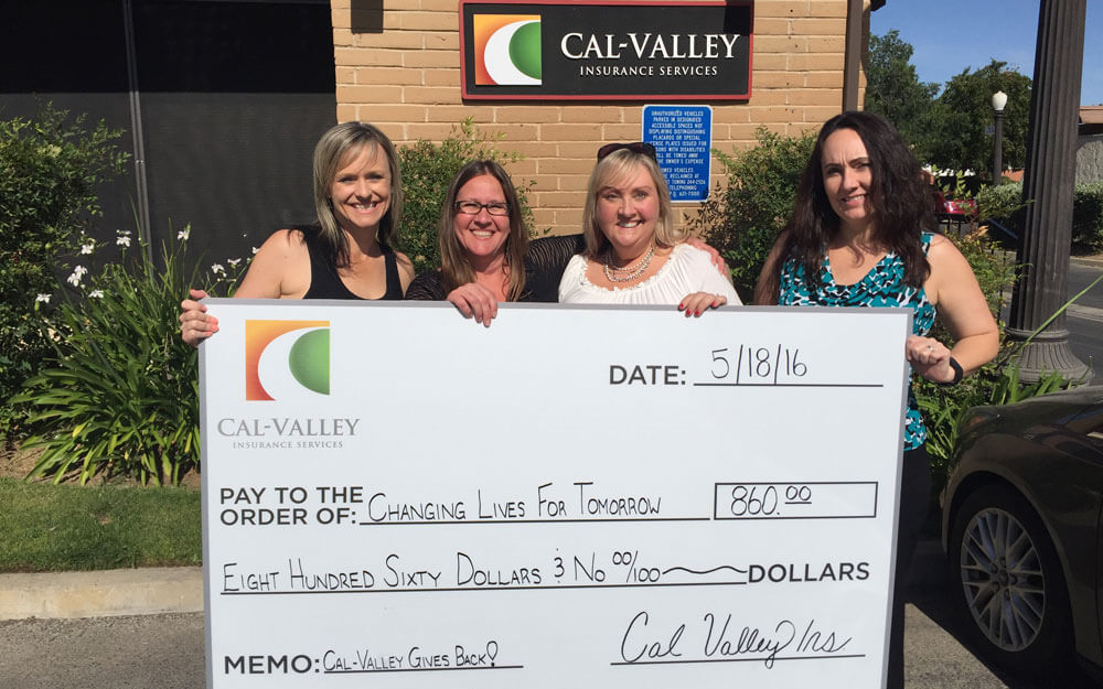 Kelly, Lisa & Rhonda presenting a check to CLFT